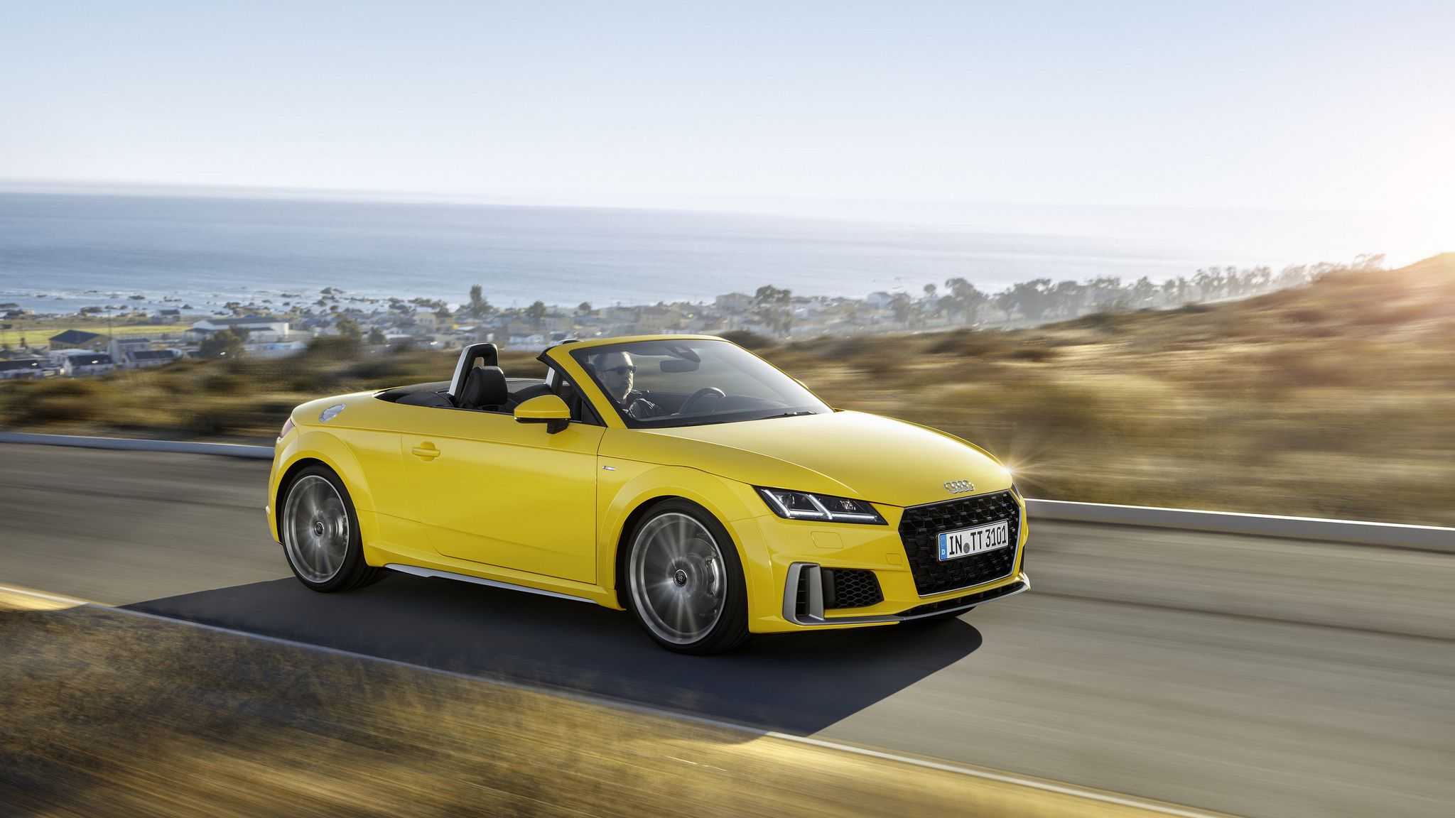 2019 yellow Audi TT Roadster