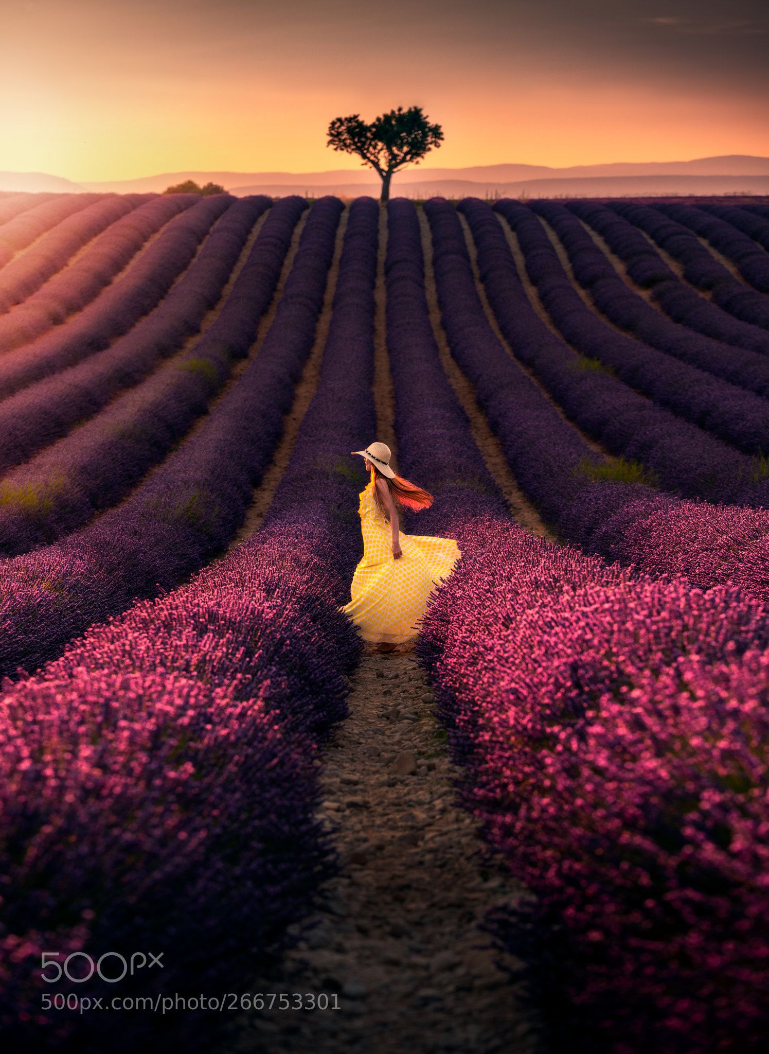 a girl in white dress at dawn