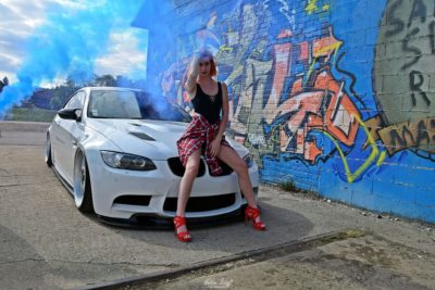 tuned white BMW M3 E92 with a girl