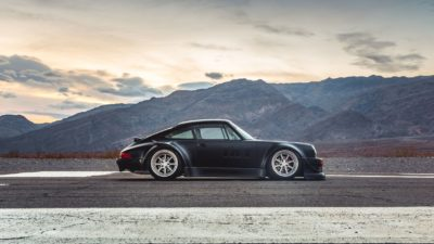 Black widebody sport car on Rotiform MLW wheels - RWB Porsche 911 (993) at landscape background
