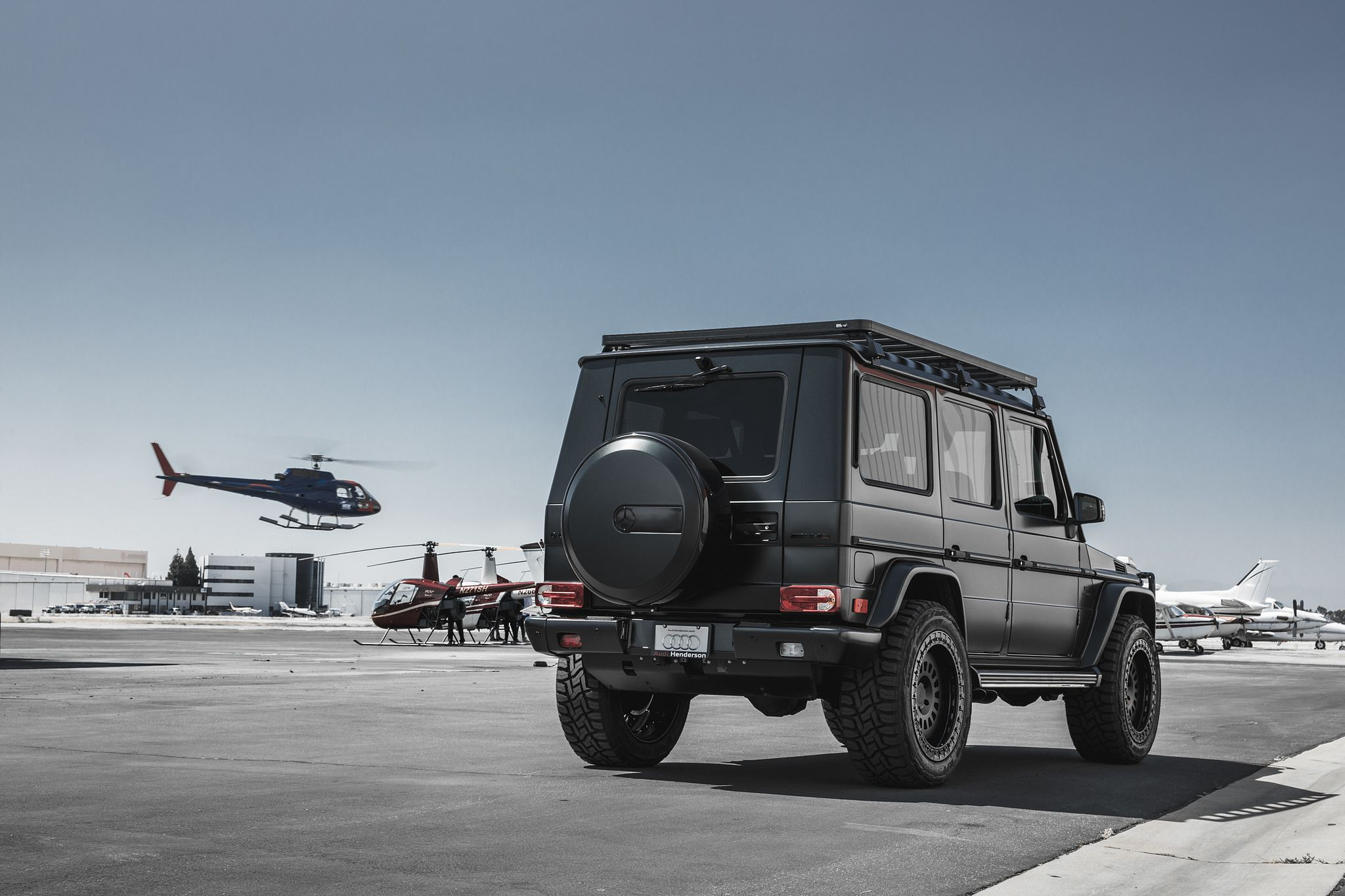 Black SUV G-Class on Rotiform CCV-OR wheels - Mercedes-Benz G63 and helicopter