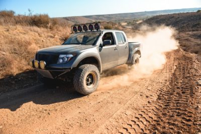 off road suv - dark-grey Nissan Frontier SE at speed