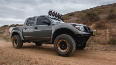 off road suv - dark-grey Nissan Frontier SE side view