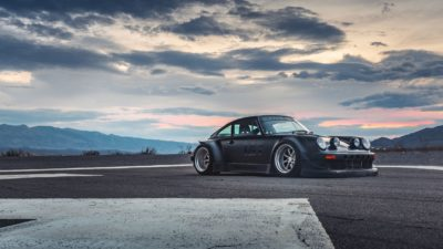 Black widebody sport car on Rotiform MLW wheels - RWB Porsche 911 (993) in the storm