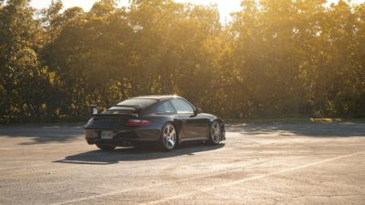Black sport car on Rotiform CBU wheels - Porsche 911 Turbo (997)