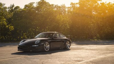 Black sport car on Rotiform CBU wheels - Porsche 911 Turbo (997) in sunbeams