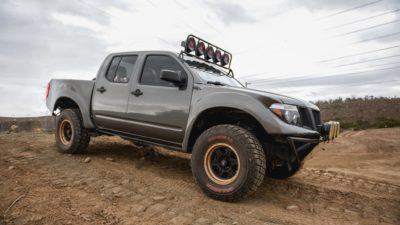 off road suv - dark-grey Nissan Frontier SE on big wheels