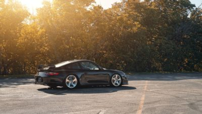 Black sport car on Rotiform CBU wheels - Porsche 911 Turbo (997) MK1