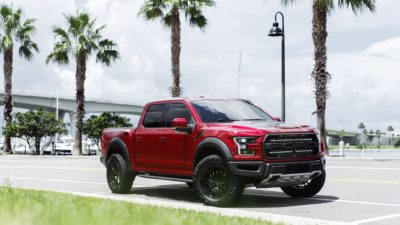 Truck on black Rotiform HUR wheels - 2017 red Ford Raptor F-150 HD image