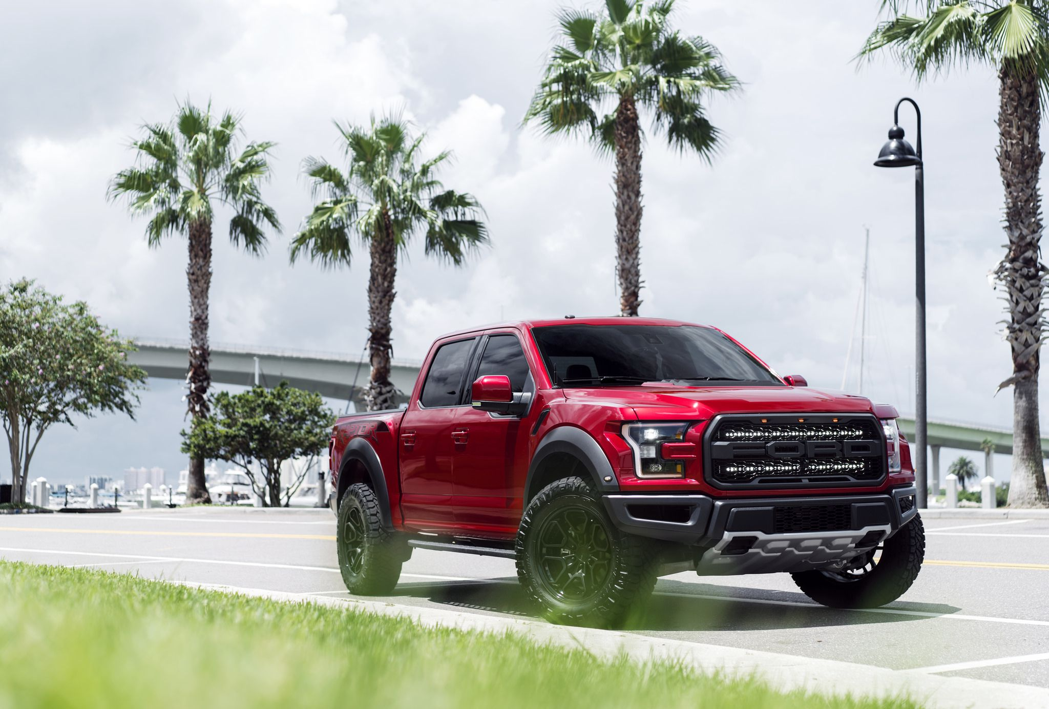 Truck on black Rotiform HUR wheels - 2017 red Ford Raptor F-150 exterior