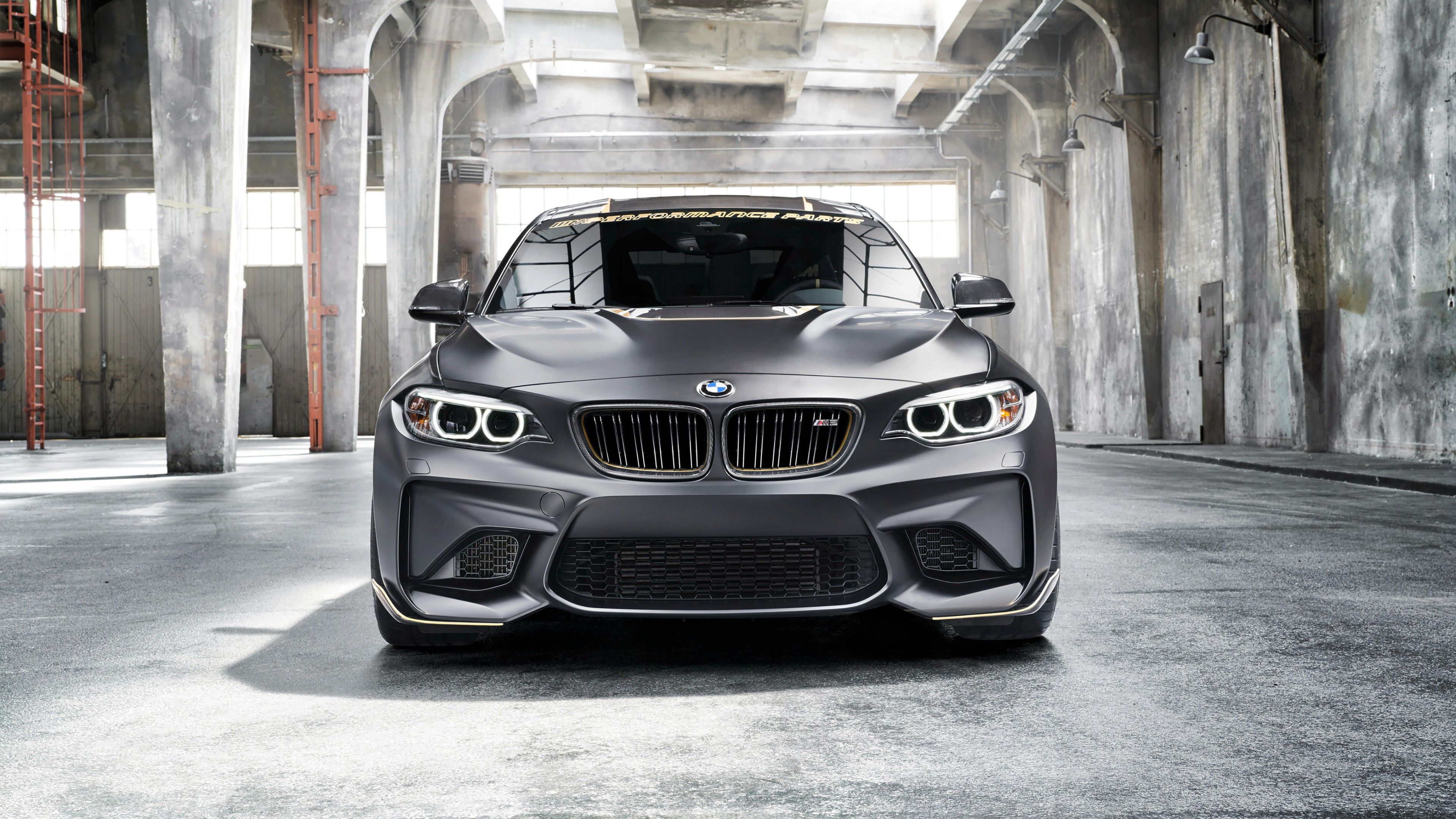 2018 black BMW M2 LCI headlights turned on