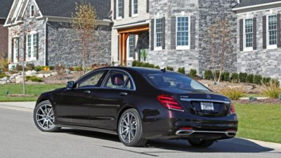 2018 black Mercedes Benz S Class S 450 Sedan near a stone house