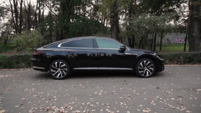 VW 2.0 TDI 5dr sedan side view - 2018 black Volkswagen Arteon
