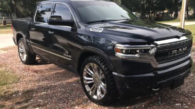2019 black Dodge Ram 1500 Limited on silver wheels