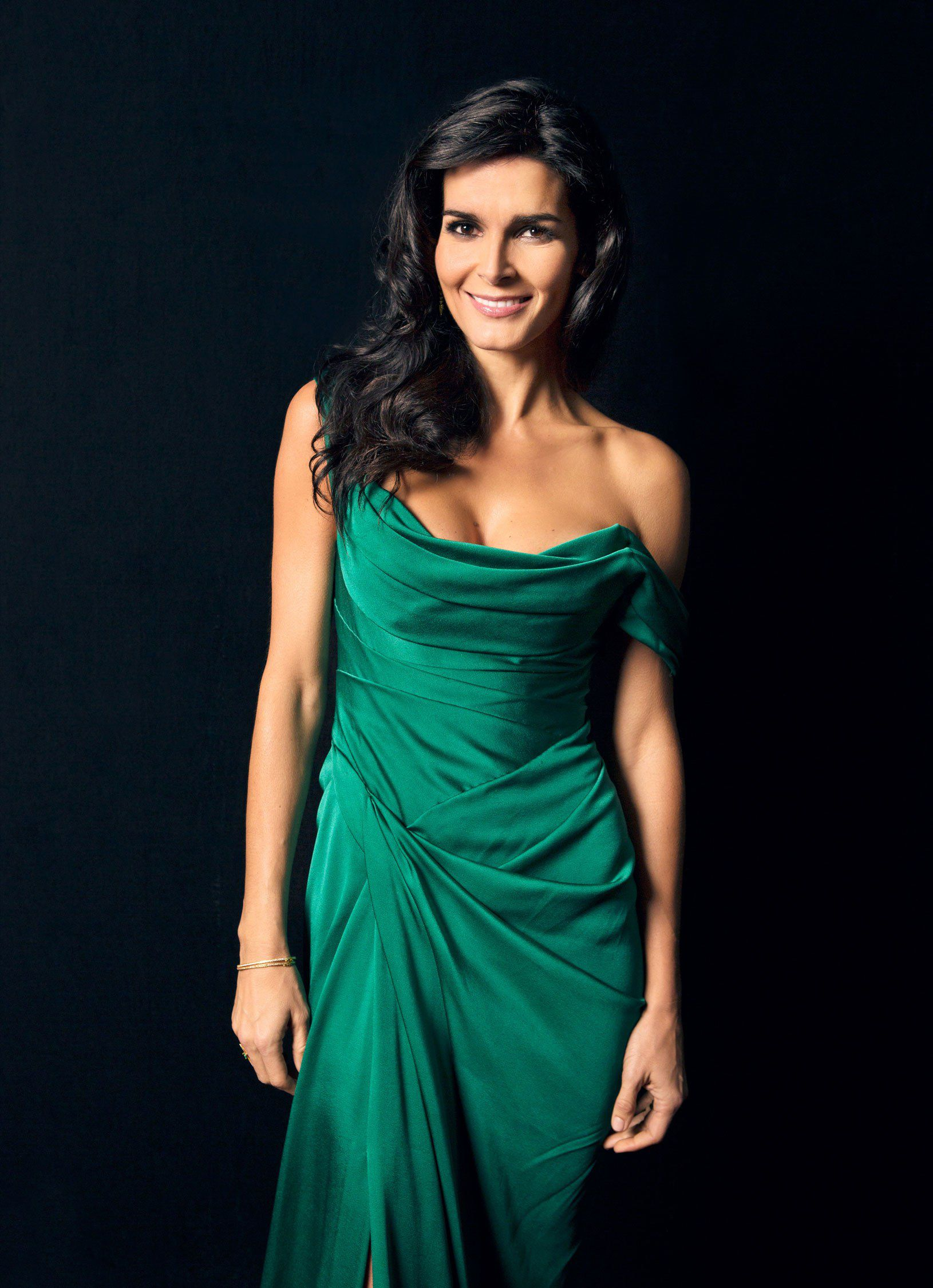 Angie Harmon in beautiful dress at black background
