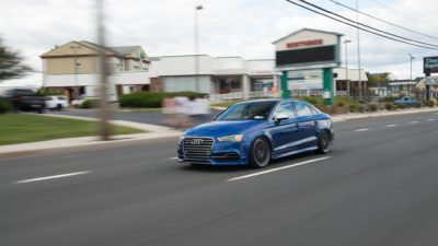 Rotiform LHR wheels - blue Audi S3 sedan at speed