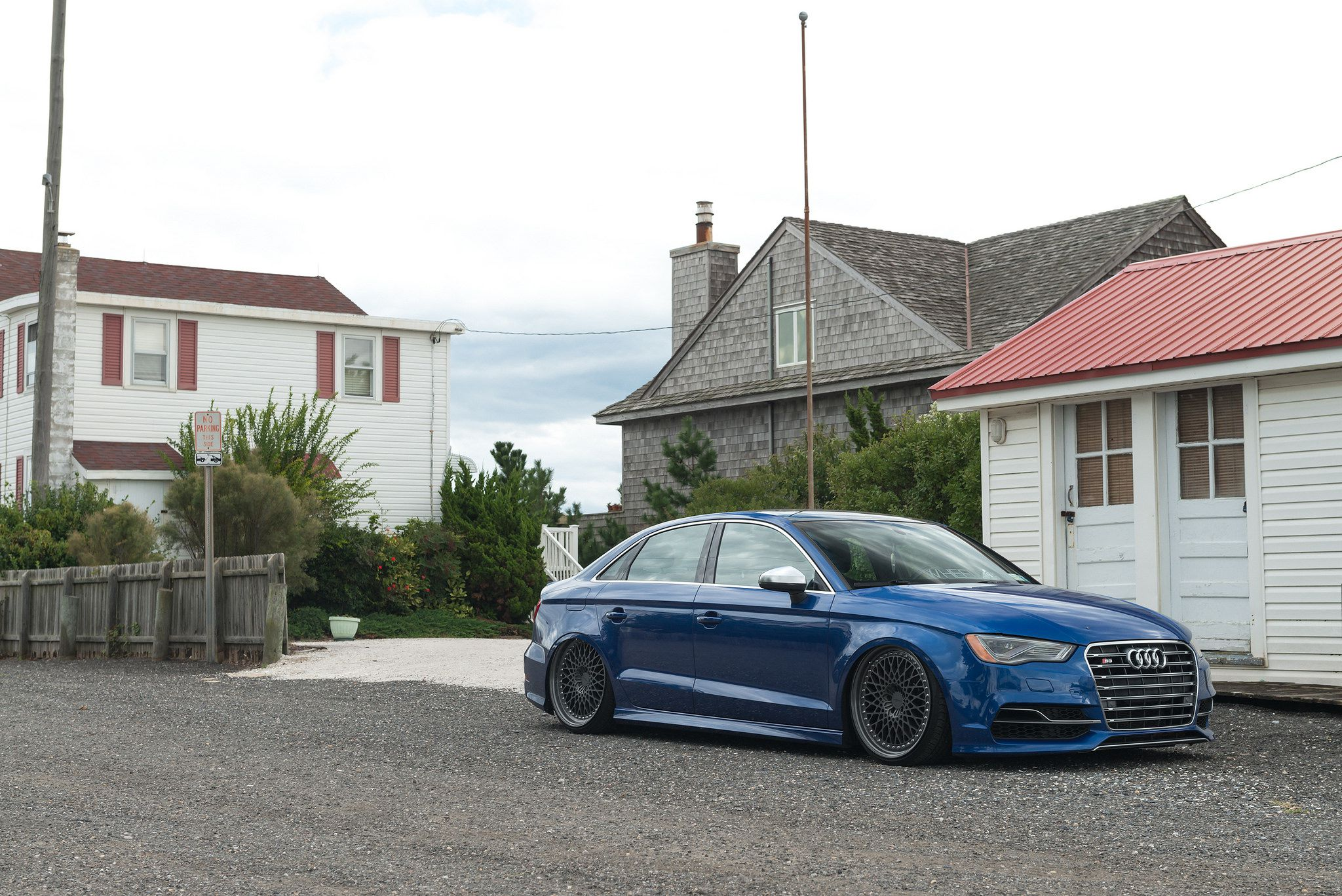 Rotiform LHR wheels - blue Audi S3 sedan side view