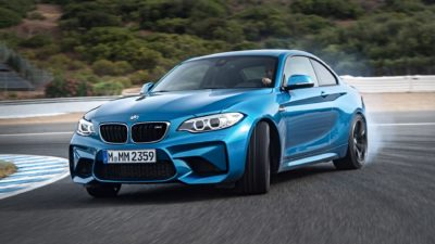 Full HD image of 2018 blue BMW M2 LCI at drift