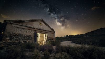 Amazing view on the Milky Way from at old house background