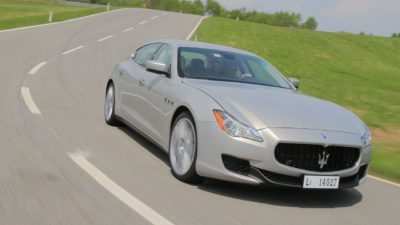 Grey luxury sedan Maserati Quattroporte S Q4 GranLusso at speed