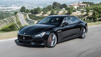 Black luxury sedan Maserati Quattroporte S Q4 GranLusso on road