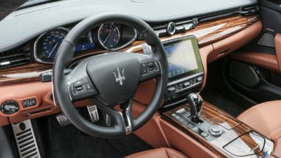 Two colour leather interior of luxury sedan Maserati Quattroporte S Q4 GranLusso steering wheel and dashboard