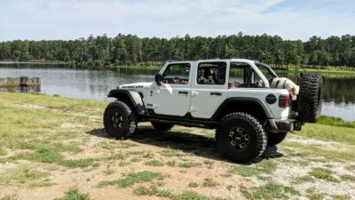 white Wrangler JL Unlimited Rubicon on Rhino Gusset wheels on sand