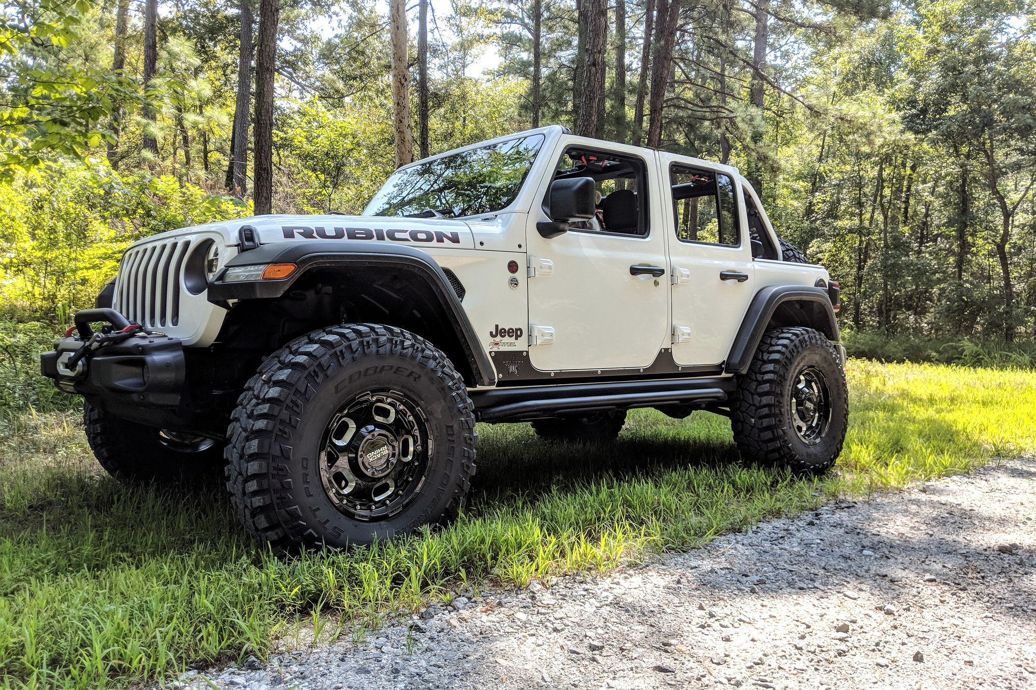 white Wrangler JL Unlimited Rubicon on Rhino Gusset wheels offroad