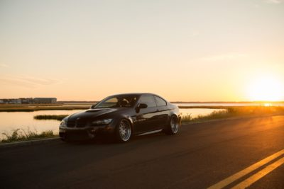 Rotiform LVS wheels - black BMW M3 coupe at sunset