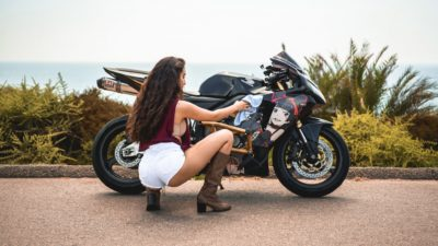 brunette girl on honda cbr600rr in HD