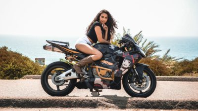 brunette girl on honda cbr600rr in high quality