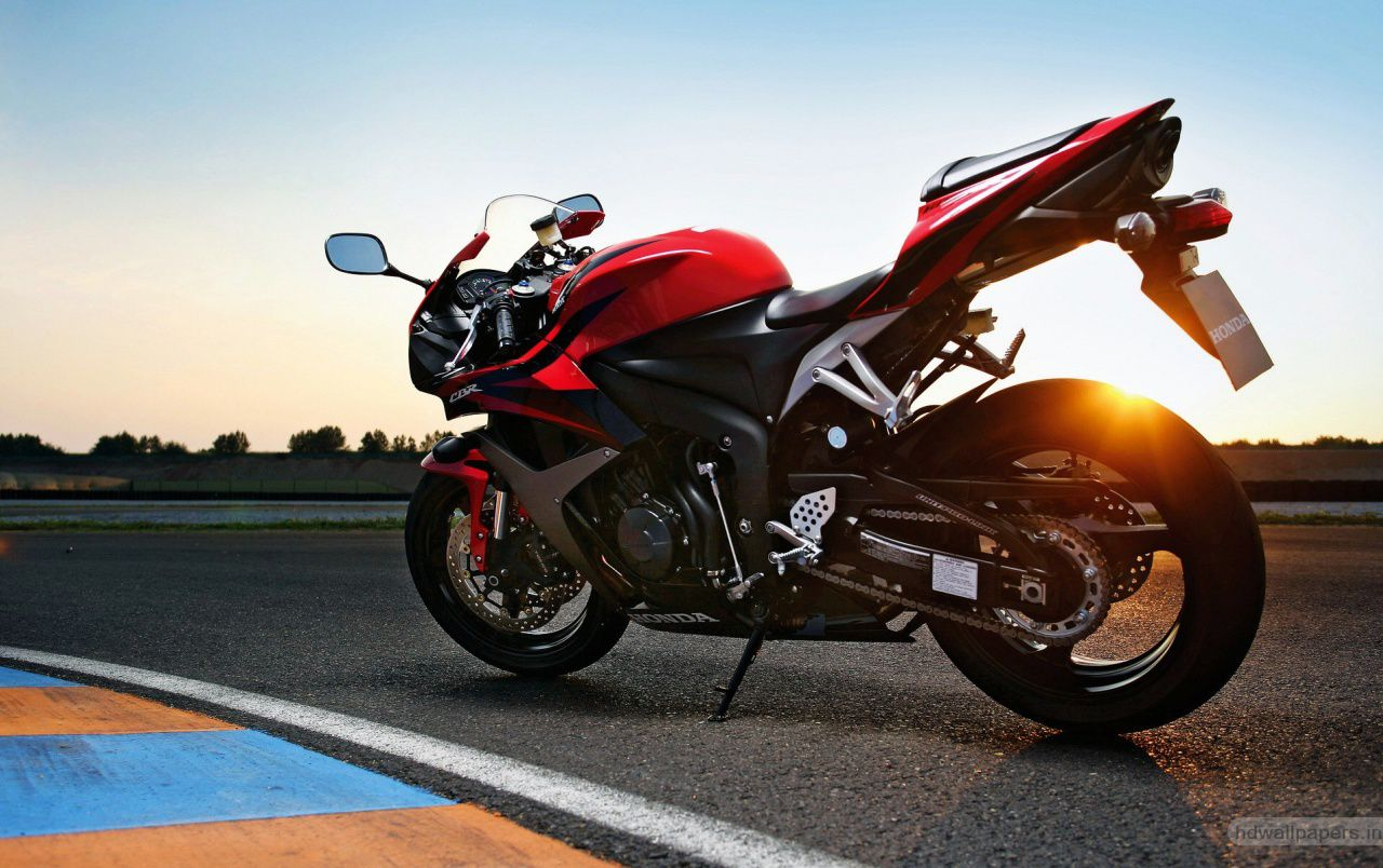 Sportbike - red honda cbr600rr at sunset