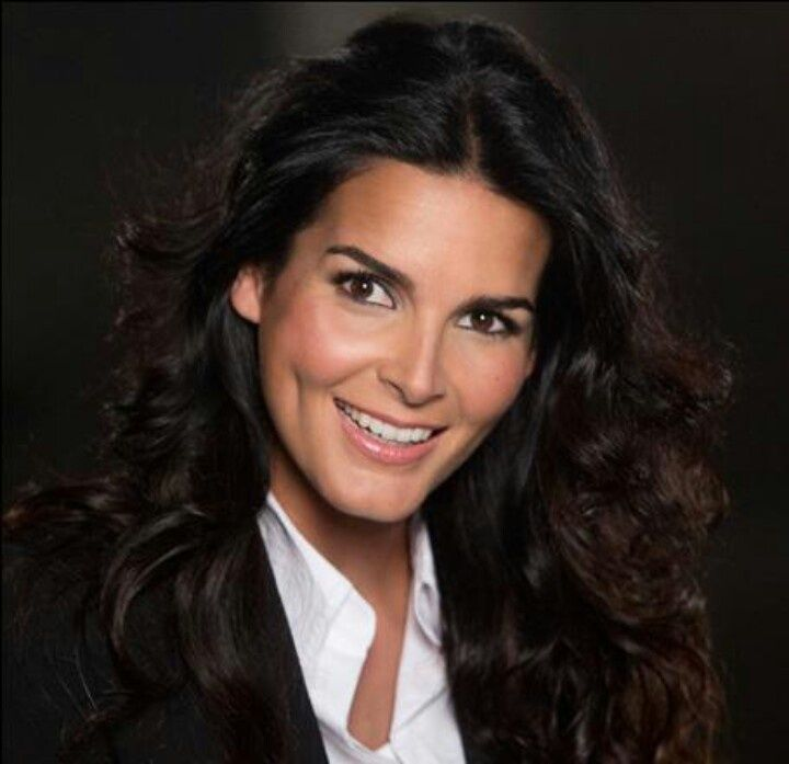 smiling Angie Harmon in white t shirt