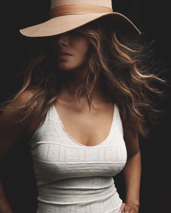 stylish Halle Berry in leather hat