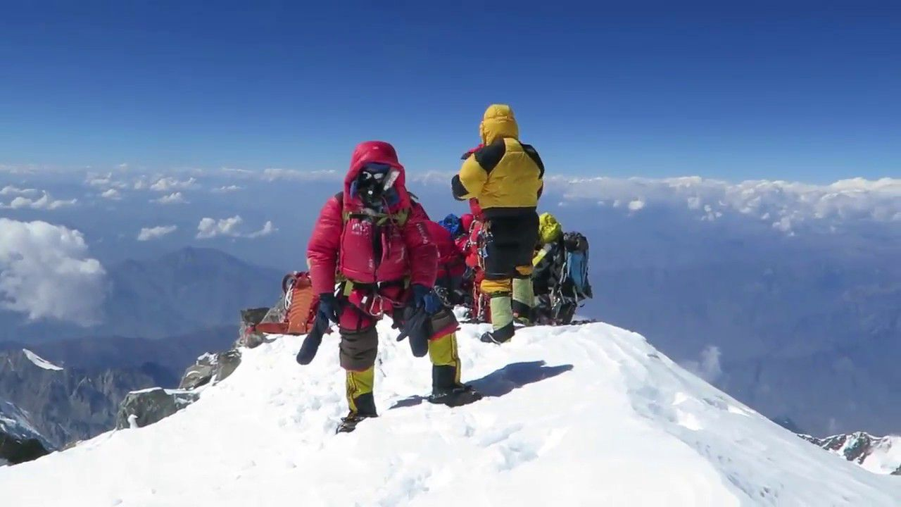 Two peoples on the oeak of mount Nanga Parbat in October 02 2017