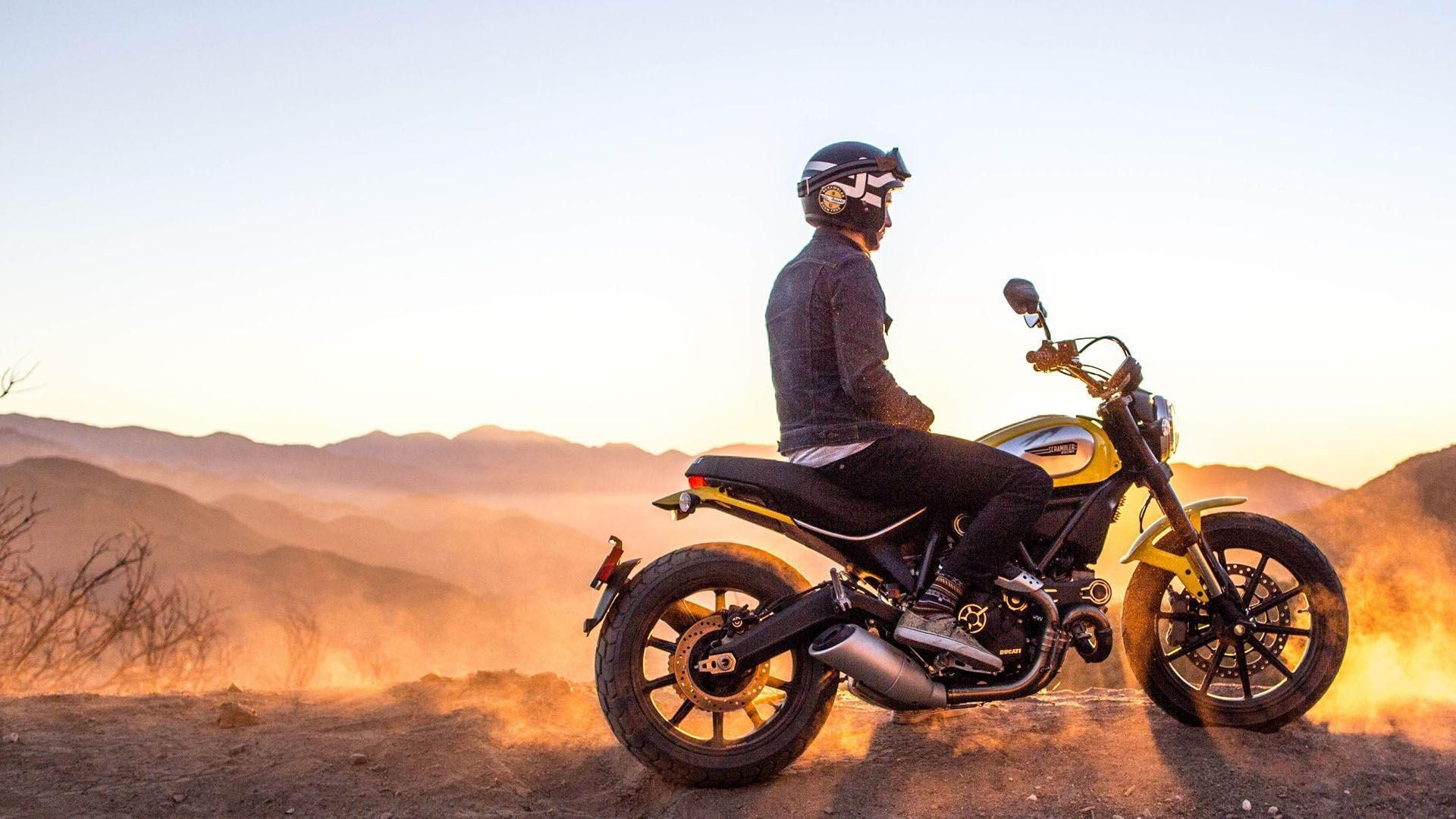 a rider on the Ducati Scrambler at travel