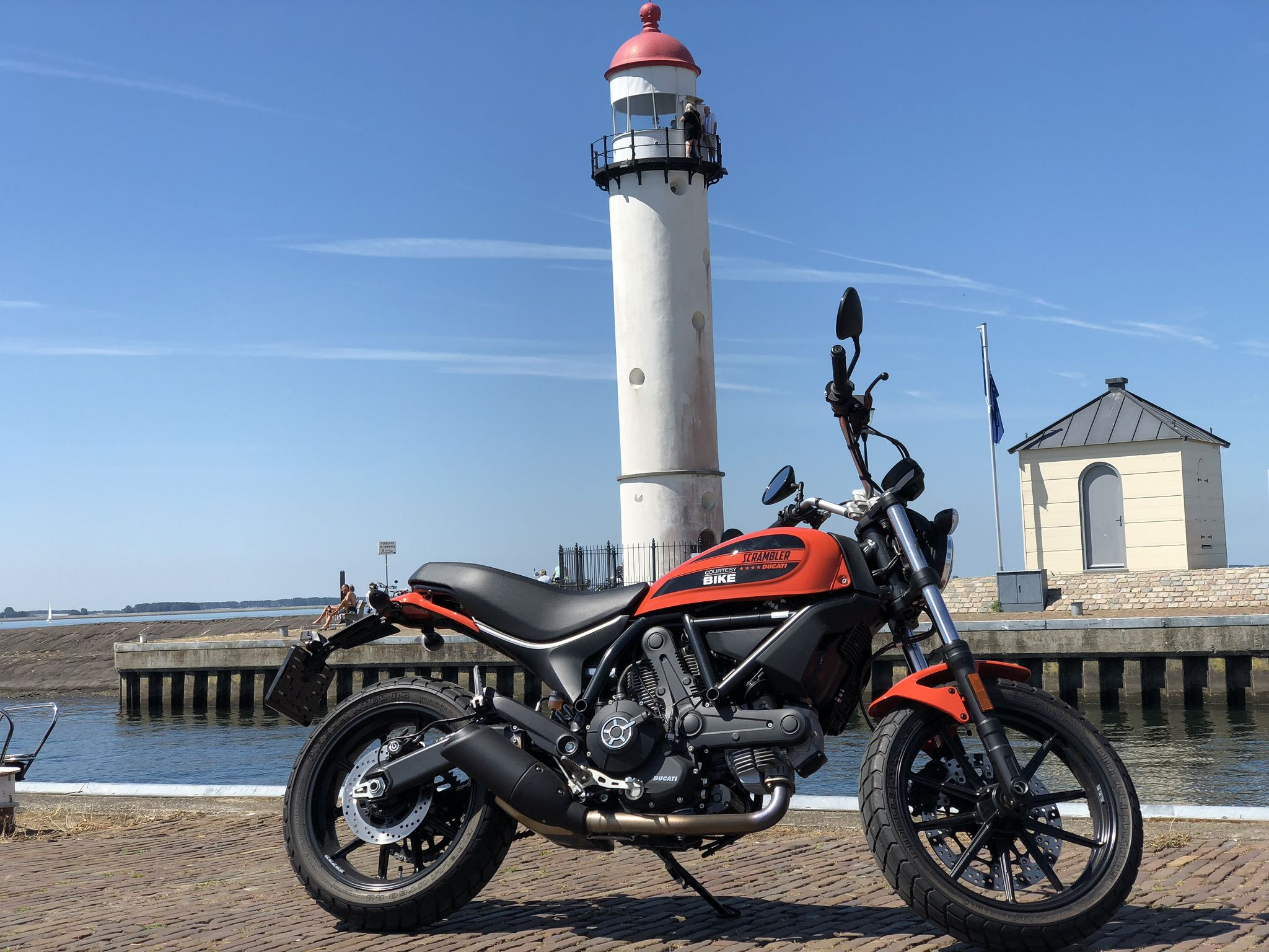 Lighthouse, red Ducati Scrambler