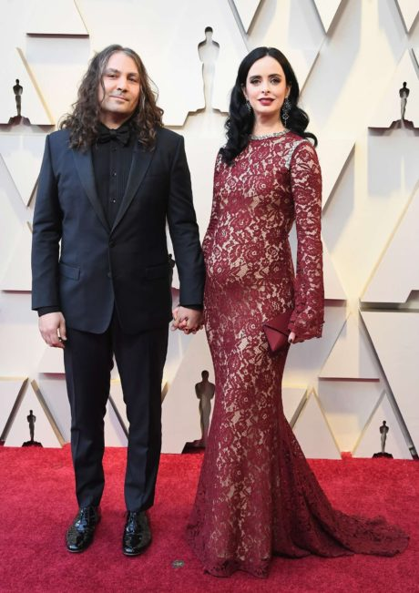 Photo 01: Krysten Ritter in red dress with boyfriend at the Oscars in Los Angeles, 2019