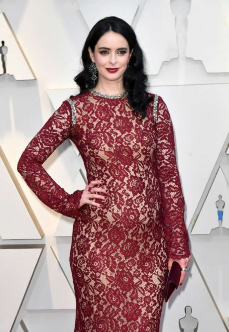 Photo 03: Krysten Ritter in red dress at the Oscars in Los Angeles, 2019