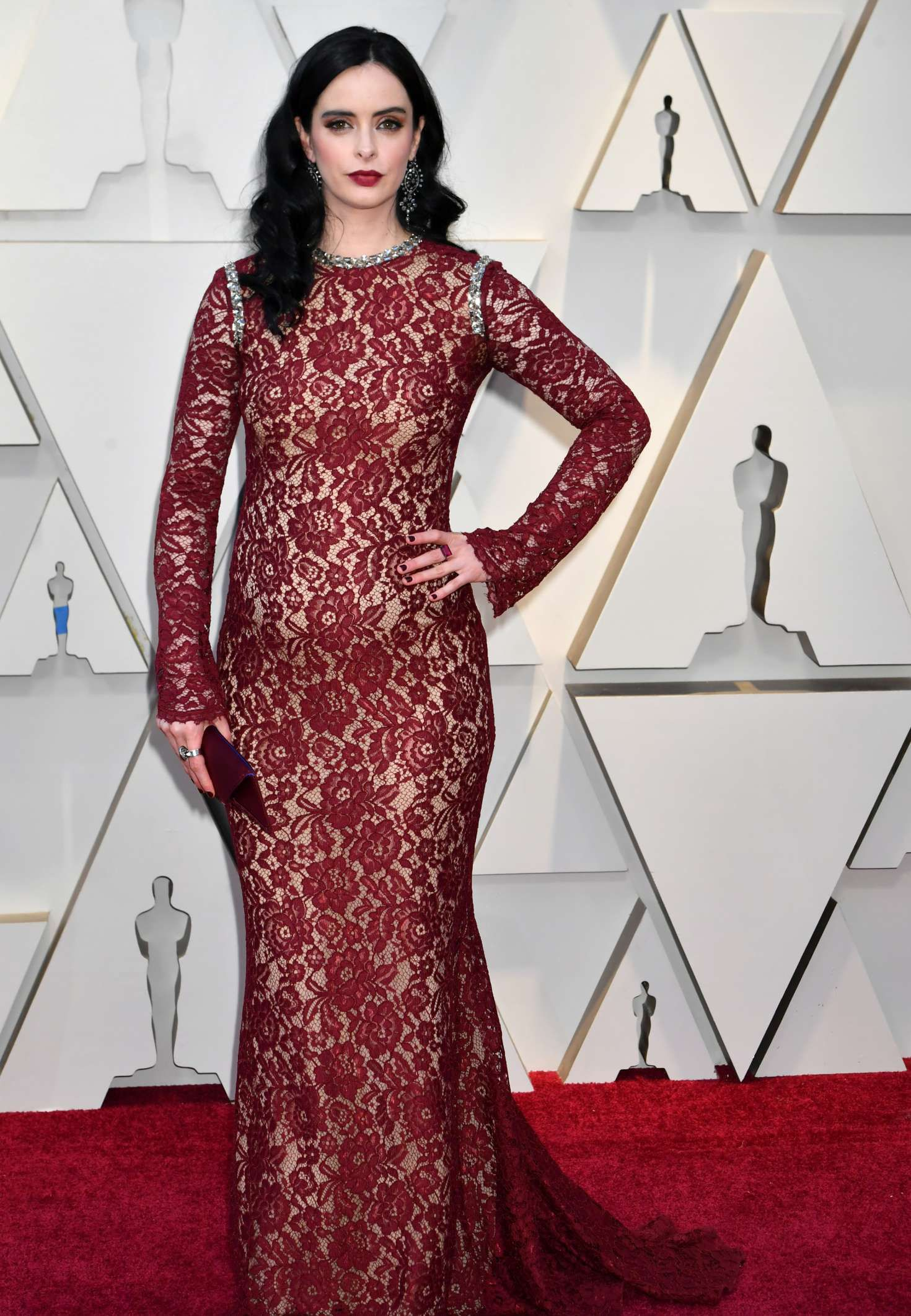 Photo 04: Krysten Ritter in red dress at the Oscars in Los Angeles, 2019