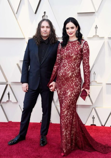 Photo 05: Krysten Ritter in red dress with boyfriend at the Oscars in Los Angeles, 2019