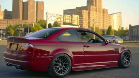 red bmw m3 e46 at city background