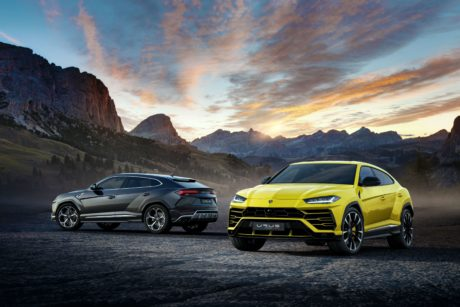 2019 Lamborghini Urus yellow and dark grey at sunset background