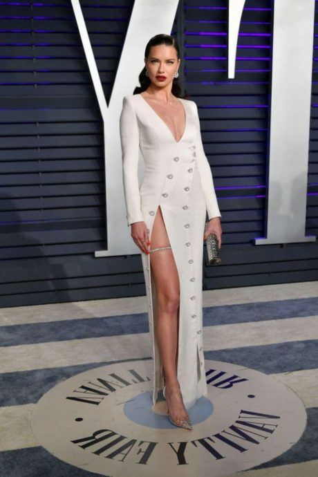 Adriana Lima in dress with cut on leg at Vanity Fair Oscar Party