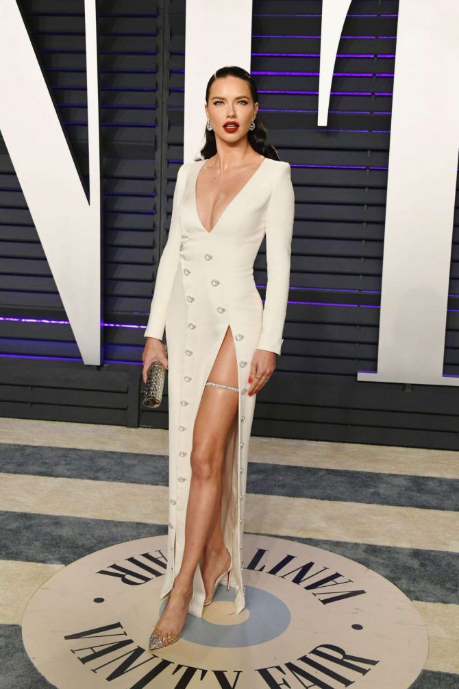 Adriana Lima in long white dress at Vanity Fair Oscar Party