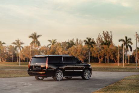 Cadillac Escalade on custom Juggernaut 26 inch silver wheels