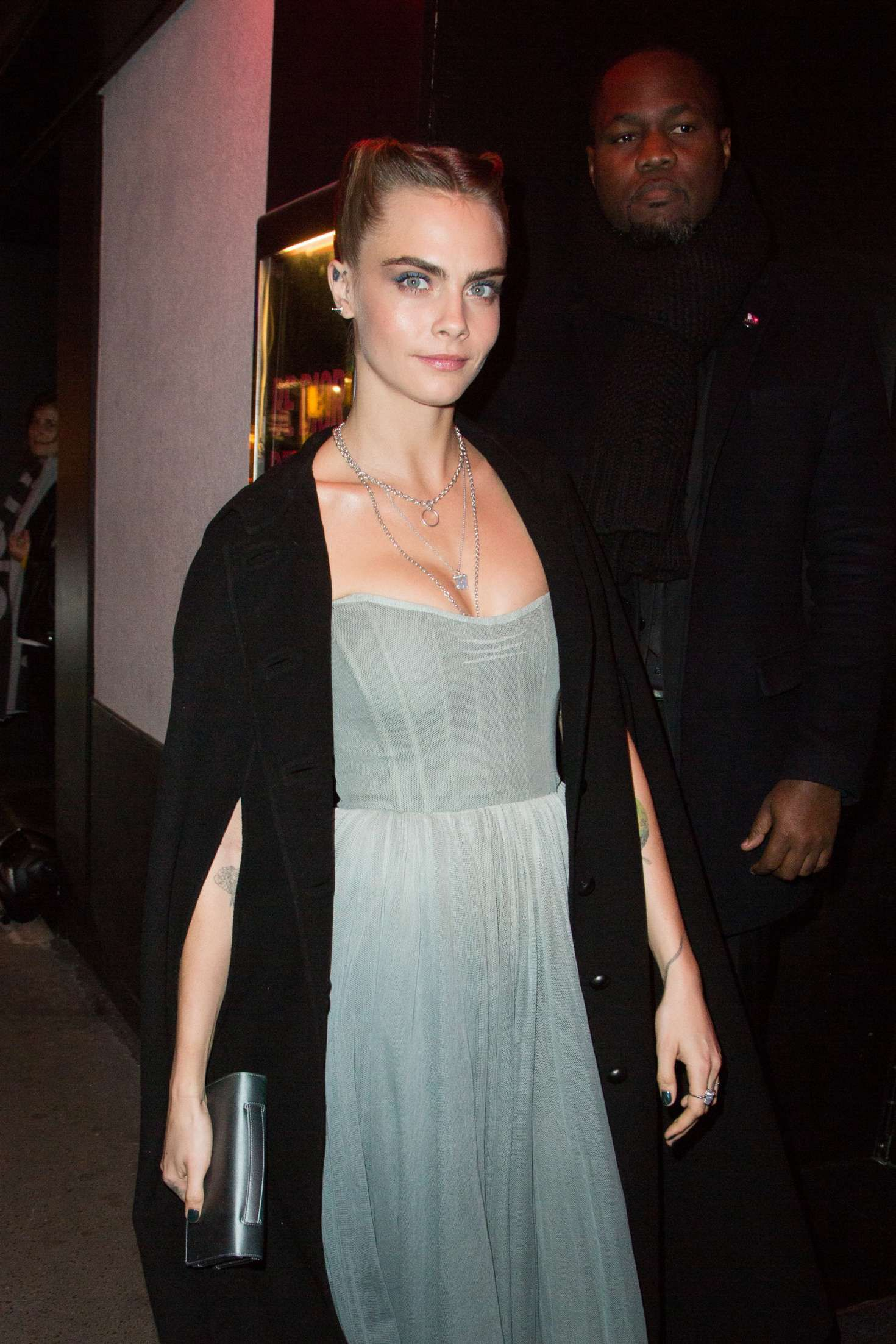 Cara Delevigne with short hairstyle at the PFW in Paris, 2019