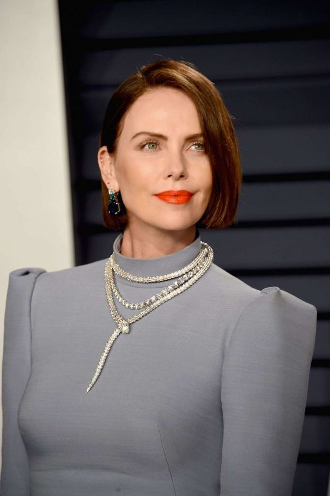 Charlize Theron with red lips at Vanity Fair Oscar Party 2019