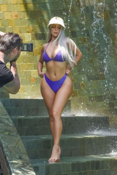 Demi Rose poses for a camera in purple bikini, Thailand
