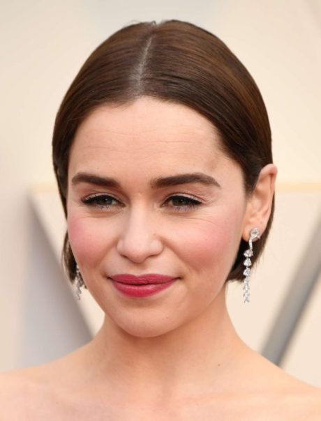 Emilia Clarke with new earrings at the Oscars in Los Angeles, 2019